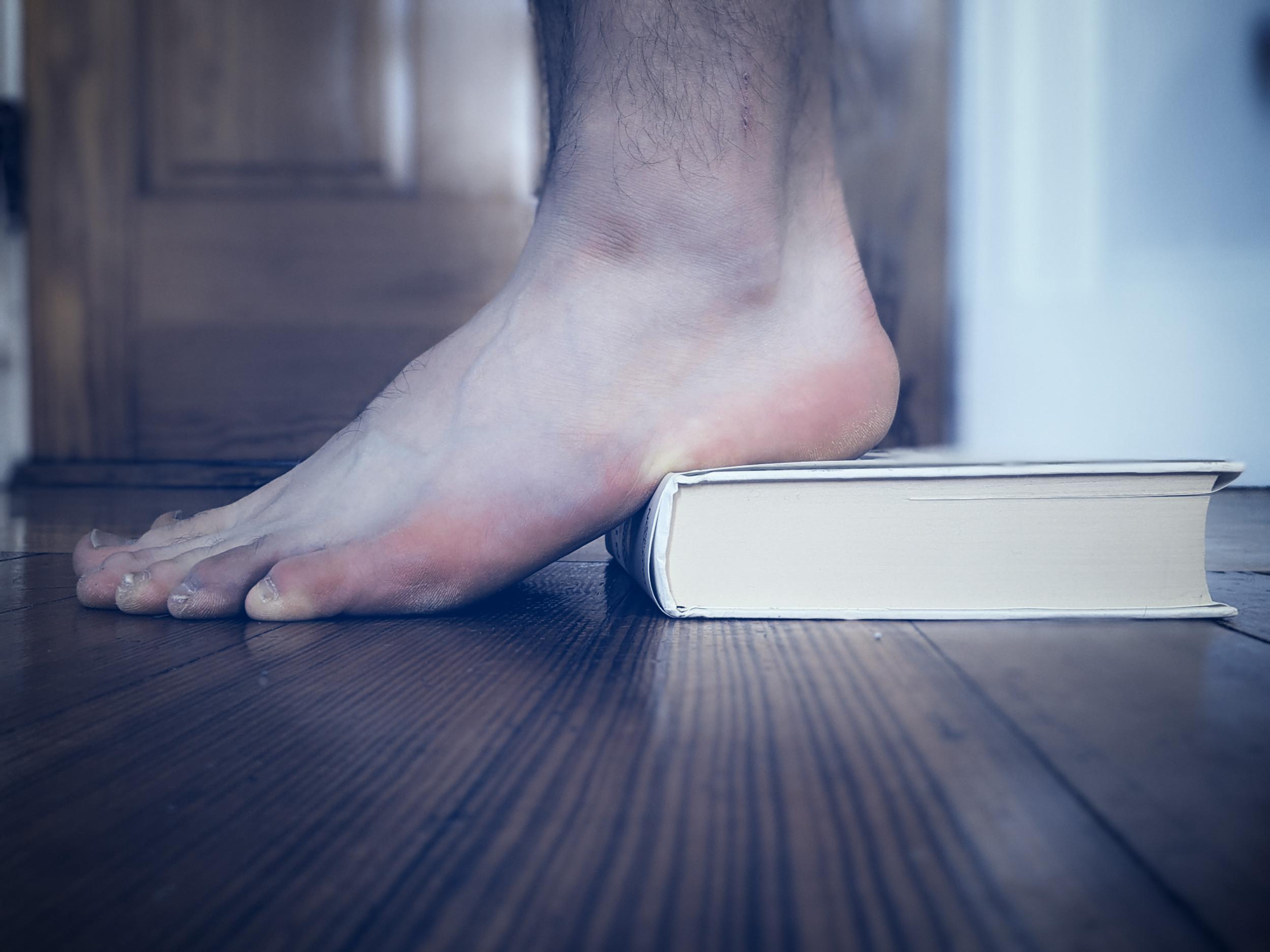 Feet on book heel raise